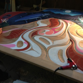Applying paint and line work to bench project, studio of Donald Varnell 2013
