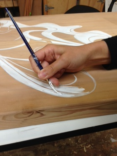 Applying paint and linework to bench project, studio of Donald Varnell 2013